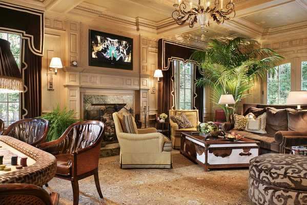 Gorgeous Interiors - living room featuring an exceptional Antique Persian Tabriz Rug from Nazmiyal